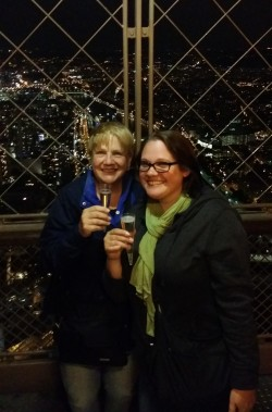 My mother and me on the top floor of the Eiffel Towel in Paris, France, enjoying a celebratory glass of Champagne.